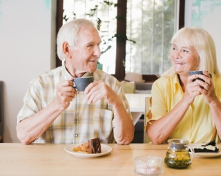 Happy older couple drinks coffee